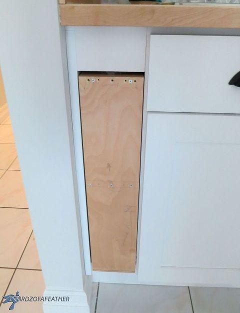 Diy Hidden Kitchen Storage Turn A Filler Panel Into A Pull Out Cabinet Hidden Kitchen Kitchen Storage Kitchen Base Cabinets