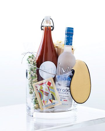 Fill an ice bucket with celebratory staples for a party-style welcome gift