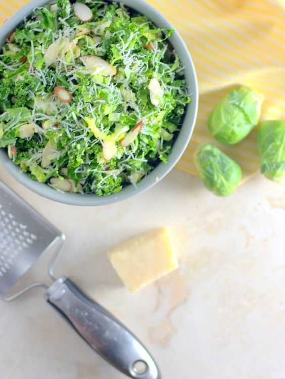 Kale & Brussels Sprouts Salad with Toasted Almonds & Lemon Dijon Vinaigrette | from Saucy Pear