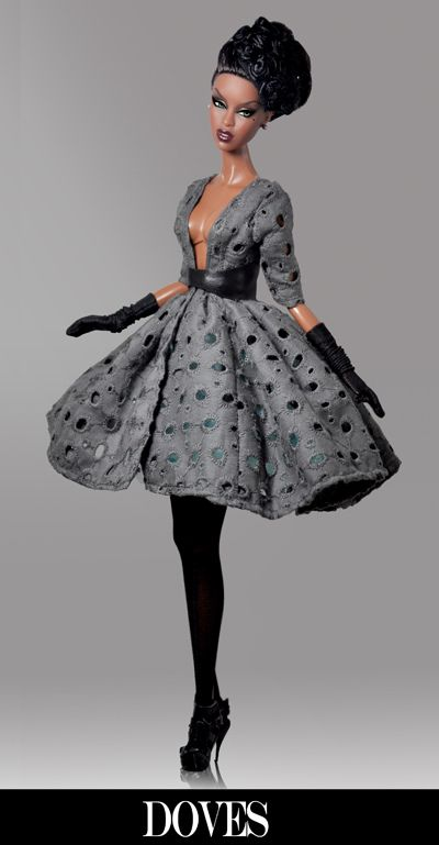 Beautiful, fierce black doll in flared dress and gloves. up-do