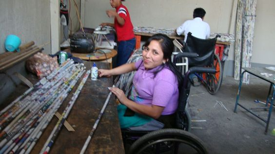 Miriam, a Trickle Up participant from Guatemala at her workstation creating handicrafts. ADISA, a Trickle Up partner organization, helps people with #disabilities secure jobs like this making handicrafts, which double as physical therapy for improving their motor skills.