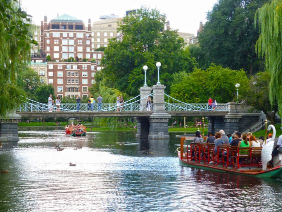 The Boston Public Garden, Boston, Massachusetts, established in 1856 and designed by George Meacham. The swan boats have been a part of the garden since 1877, the oldest one in use today dates back to 1918