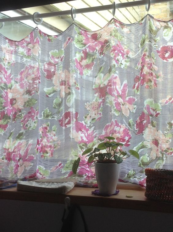 Upcycled scarf as cafe curtain with curtain pole rings on a ...