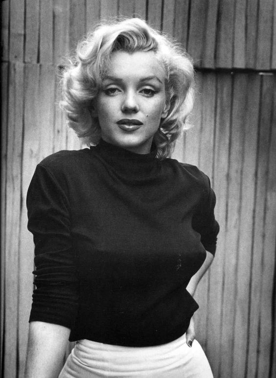 """A wise girl kisses but doesn't love, listens but doesn't believe, and leaves before she is left."" - Marilyn Monroe:"