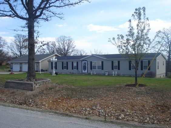 This is Beautiful 4 BR, 2 BA home on paved road, close to Pomme de Terre Lake! There is a family room with a gas log fireplace, kitchen/dining room with island, master bedroom with sitting room area and large tub and walk in shower, three more bedrooms and a 3 car detached garage. Lots of extras with this home, such as crown moulding, storage space galore, a storm shelter under the rear wraparound deck and a patio connecting the house and the garage. The lot is all open 1.9 acres in…