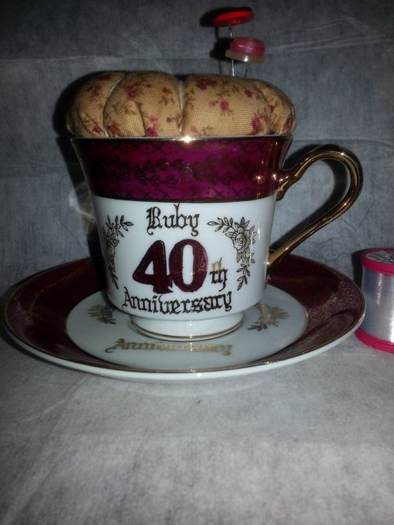 Pincushion in a vintage cup and saucer  https://www.etsy.com/listing/167970438/pincushion-in-a-lovely-vintage-cup-and