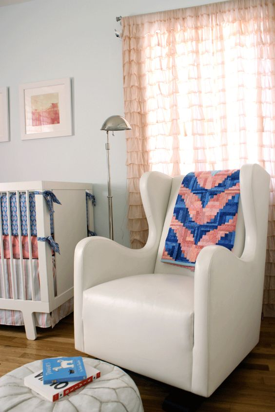How fun is this quilted chevron blanket over the glider?! Such an eclectic touch to this modern nursery! #nursery