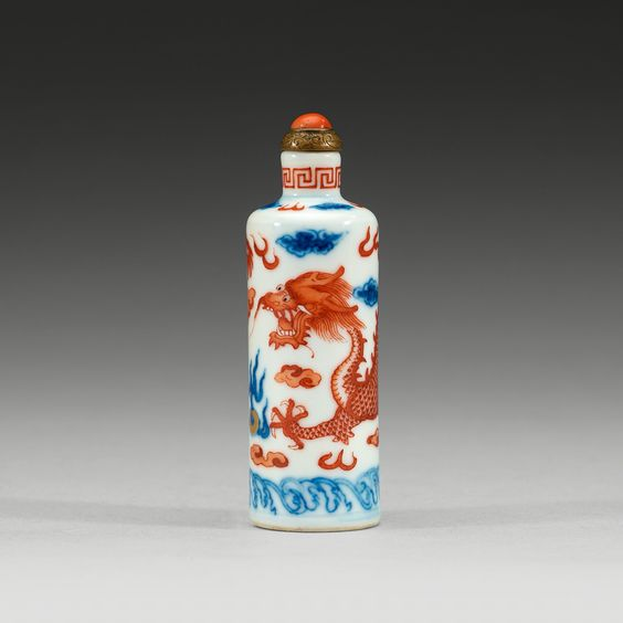 A very fine Chinese porcelain snuff bottle with a dragon done in rust red glaze.