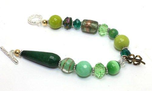 Gorgeous bracelet.  Apple green jade, faceted sea foam green agate, green tiger eye glass, tear drop shape faceted green agate, Lampwork beads and bronze 4 leaf clover.  www.ayadesigns.artfire.com