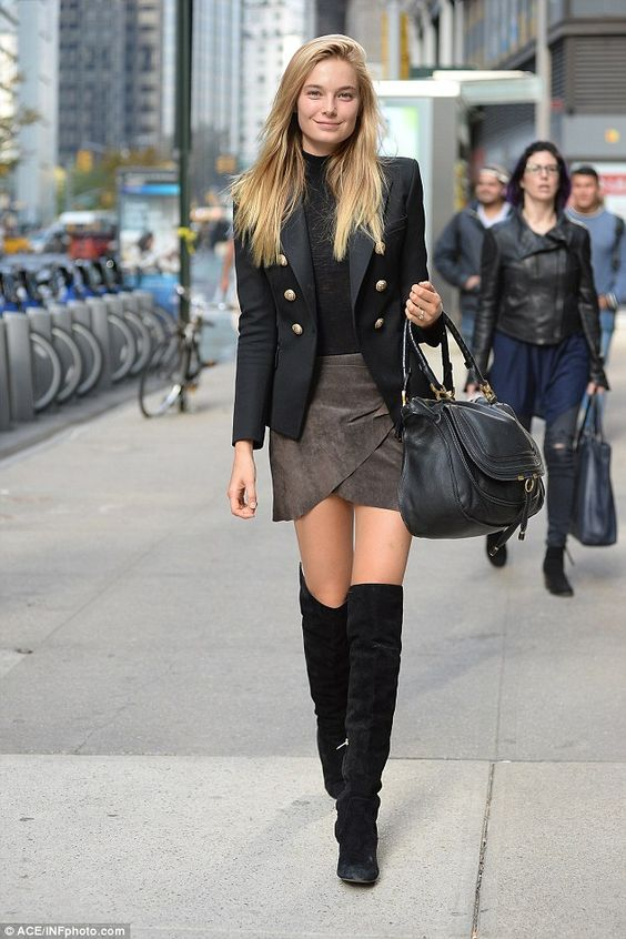 Stunning:The statuesque blonde beamed as she flaunted her slender frame in a grey miniskirt and black thigh-high boots