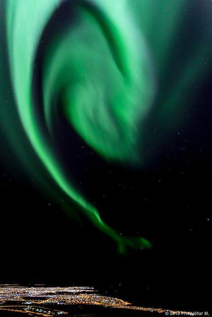 Aurora over Reykjavík's city lights, Iceland (by Friðþjófur M. on Flickr)