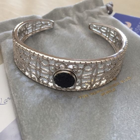 Sterling Silver Filigree Bangle Sterling silver filigree bangle part of the Karisma fine jewelry collection. Center stone is interchangeable. Bangle comes with black and red inserts in jewelry store dust bag. Karisma Collection Jewelry Bracelets