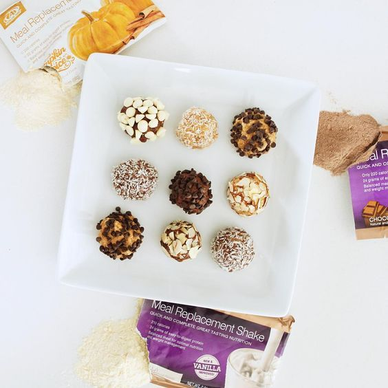 One packet of any flavor Meal Replacement Shake, 1/4 cup of all natural peanut butter and 2 tablespoons of honey.  Roll into balls and roll in chocolate chips, nuts etc. Delish!