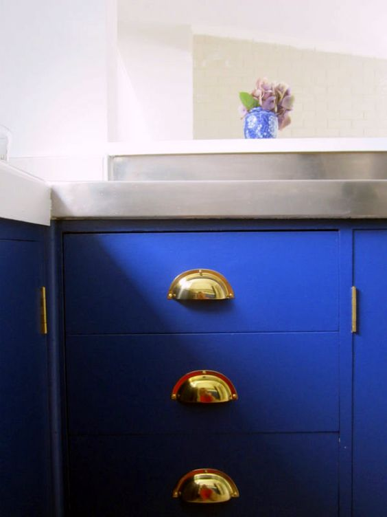 """""""Four Under One Roof"""" cover multiple drawers with one cabinet door or at drawers to a cabinet, they are hidden and maybe more organized.  adds a fun way to add bright color to a room but not have it always showing.  love this bright indigo, with gold pulls."""