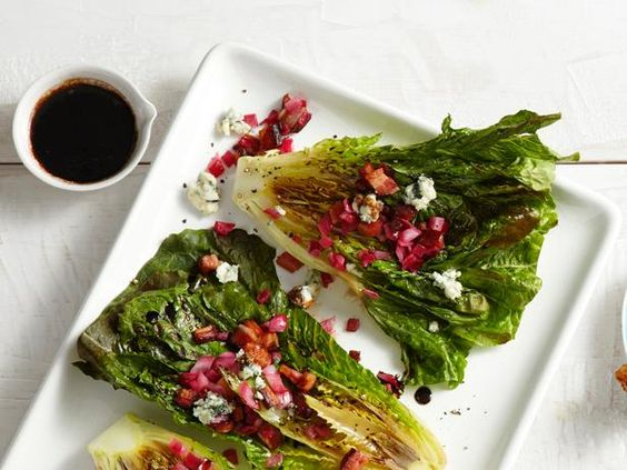 Not just for burgers and hot dogs, the grill can add a smoky flavor to lettuces as well. Guy quickly chars romaine, then tops it with a bacon-balsamic dressing and crumbled blue cheese.  #RecipeOfTheDay