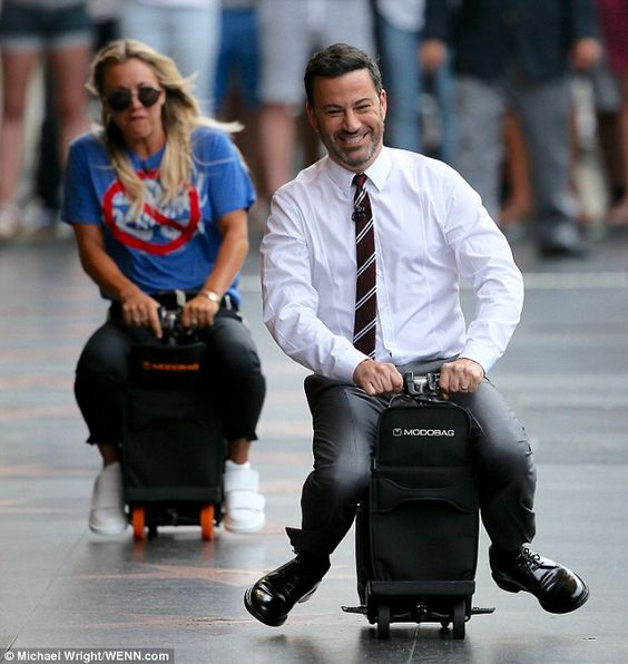Pump the gas! The 30-year-old Big Bang Theory star raced Jimmy Kimmel down the sidewalk on a motorized piece of luggage while performing a hilarious looking skit