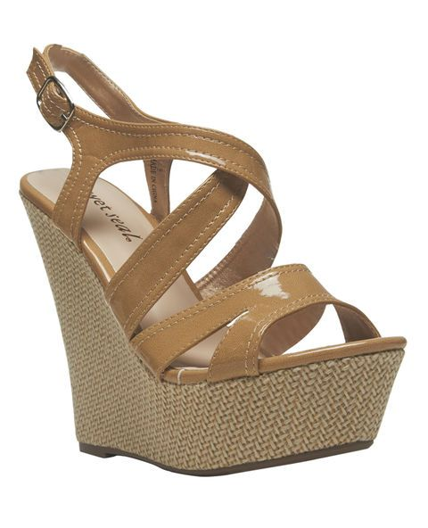 """A perfect way to dress up a warm-weather outfit, these wedge sandals have faux patent leather straps that wrap around the ankle with an adjustable metal buckle and a soft weaved pattern covering the wedge sides. Footbed is padded for comfort and sole has textured rubber.      Heel: 6"""" height / Platform: 2.5"""" height     Man Made Materials     Imported"""