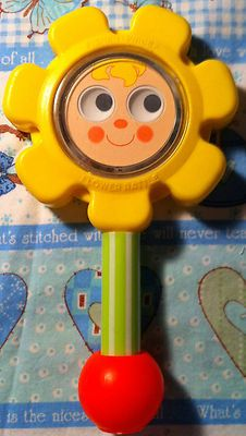 Fisher Price Vintage 1973 Baby Toy Flower rattle: my little sister had this.