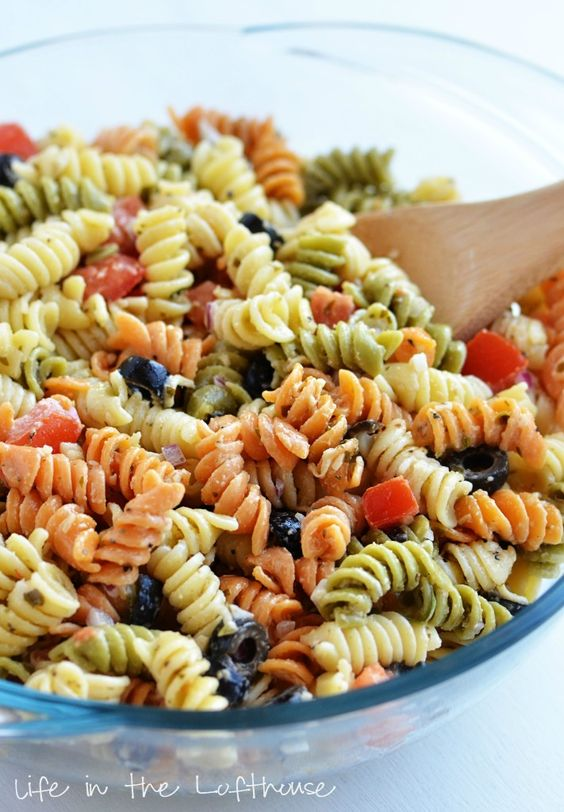 Tri Color Pasta Salad-- The flavors going on inside this salad are divine. It's coated in Caesar dressing and basil pesto (so good!) and tossed with all kinds of deliciousness; tomatoes, black olives, red onion, Parmesan cheese….  It really is amazing.