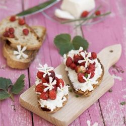 Goat cheese, wild strawberry and jasmine flower. Such a pretty bruschetta.