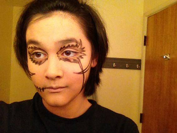 Step 2- outline the makeup design with black eyeliner...by VixonMidnight