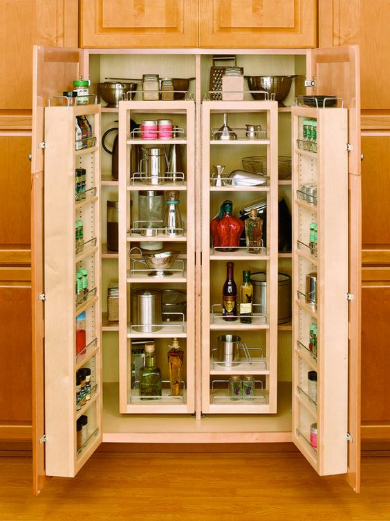 Transform conventional cabinetry into storage galore with this nifty pantry kit comprised of multiple pivot-shelved doors.