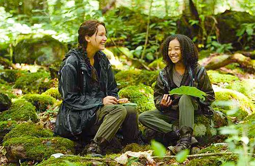 Katniss and Rue share a laugh while bonding in the arena.