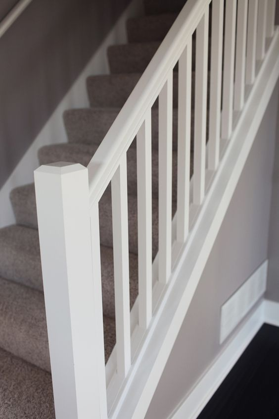 Simply spindles like this painted white with a beefy end,post with some added trim like picture previous.