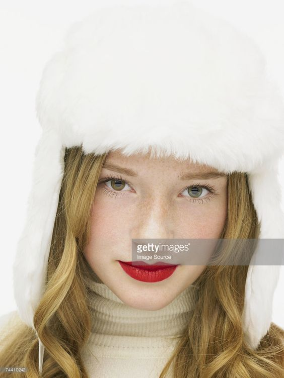 Woman wearing a white furry hat