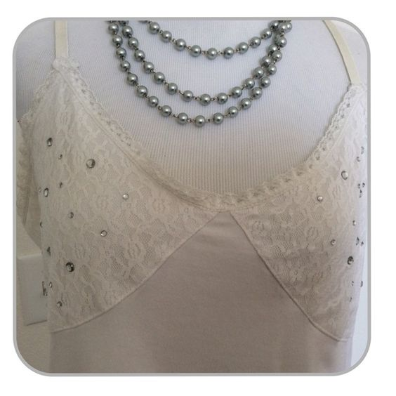 White Cami Super cute white cami. Rhinestones details on top and lace details on side. Tops Camisoles