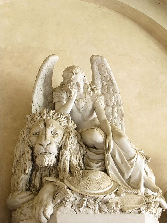 Angel and lion statue at Basilica di Santa Croce di Firenze  province of Florence , Tuscany region italy