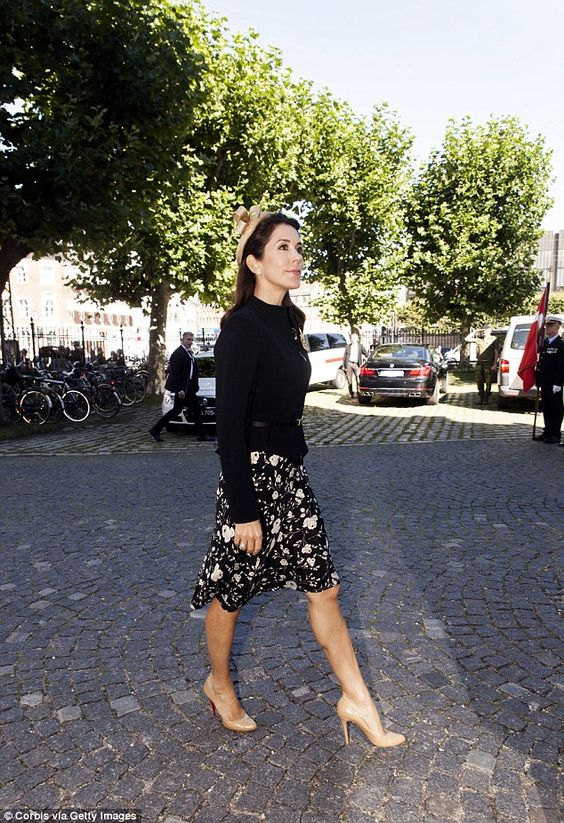 Pin-up style: The brunette opted for a 1940s inspired outfit of a printed skirt…