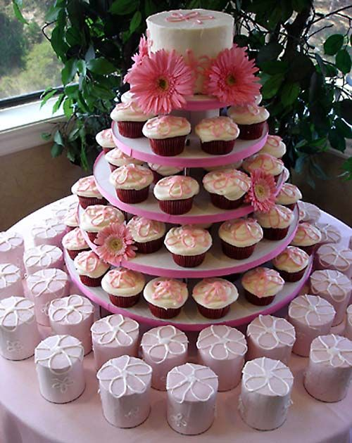 A cupcake tiered wedding cake arrangement. An assortment of cupcakes, decorated with either pink hearts, pink butterflies or pink sugar flowers. From vanessa-anne www.flickr.com: Cupcakes Multiple, Cupcakes Ideas, Wedding Cupcakes Display, Cakes Cupcakes, Cupcake Wedding Cakes, Cupcake Ideas, Creativity Cupcakes, Cupcakes Pictures