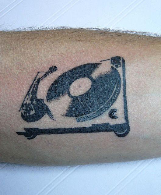 DJ EvadE's turntable tattoo. Super Dope!