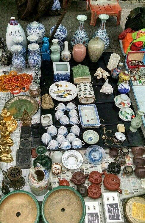 My husband shopping and taking pics at the Thieves Market in Singapore 1-10-15. I've been collecting certain pieces for a Chinese New Years party to add to my collection and I most certainly see some little gems there! 5 small bowls with red and gold dragons towards the bottom of the pic.