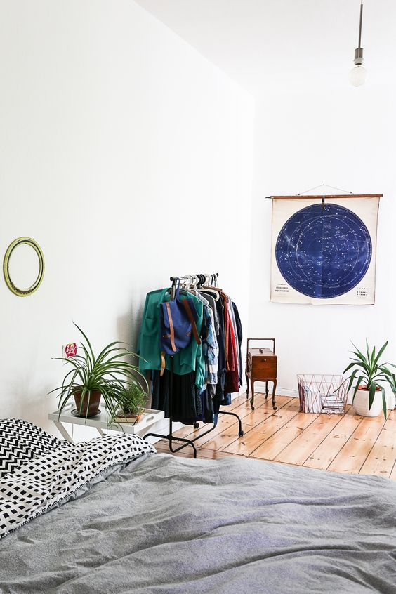 white bedroom + plants + hanging rack + astro map