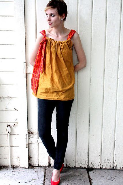 Love how she makes it so the sashes could be switched out - and the so many ways to wear it: alone, vest, cardigan, etc.