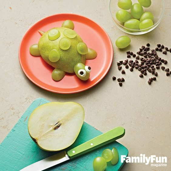 FamilyFun Make our sweet turtle treat: Arrange 4 grape halves on a plate for feet. Set a thick pear slice on top.  For the head, trim the stem end of a grape so that it's flat and place as shown. Add 2 small balls of cream cheese for eyes, with mini chocolate chip pupils, pointy side down.  Finish with a thin grape tail and grape slices on the shell.