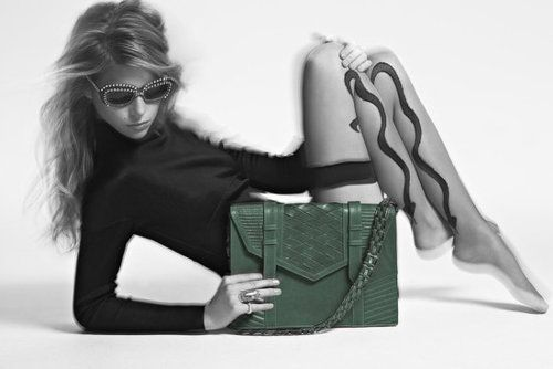 Clutching onto her Reece Hudson handbag, this model's got the right idea. we never want to let ours go either!