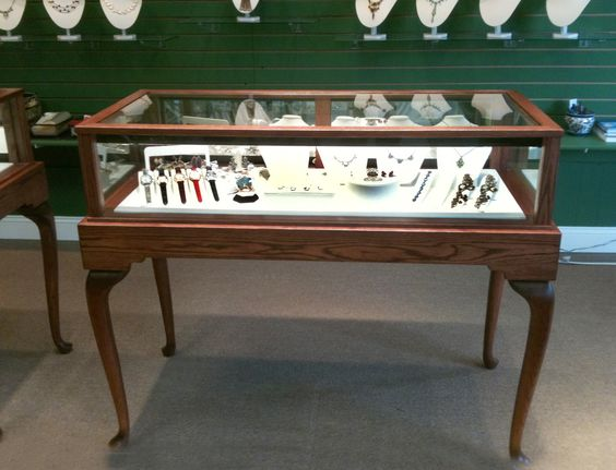 """""""The display cases are beautiful! We love the cordovon cherry stain on red oak with the white leatherette deck pad. Here are a couple of photos of the units."""" -- Canary International, Inc., Farmington, MI   -   Gloria Hsu, Partner   5/1/2012."""