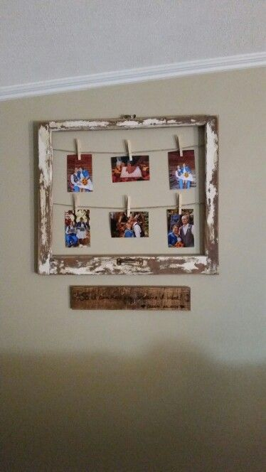 Old window frame with hemp string to suspend pictures from ...