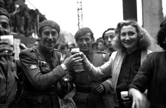 Spanish volunteers of the Blue Division celebrate their departure to Bavaria for training before heading to the Eastern Front. Although Spain officially remained neutral during the war, approximately 47,000 Spaniards would volunteer to fight for Germany. They were awarded both Spanish and German military awards, and were the only division to be awarded a medal of their own (the Spanish Volunteer Medal), commissioned by Adolf Hitler. Madrid, Spain, 1941.