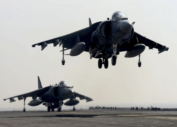 U.S. 5TH FLEET AREA OF RESPONSIBILITY (May 1, 2014)  An AV-8B Harrier lands on the flight deck of the multipurpose amphibious assault ship USS Bataan (LHD 5). Bataan is the flagship for the Bataan Amphibious Ready Group and, with the embarked 22nd Marine Expeditionary Unit, is deployed in support of maritime security operations and theater security cooperation efforts in the U.S. 5th Fleet area of responsibility. (U.S. Navy photo by Mass Communication Specialist 3rd Class Mark Hays/Released)