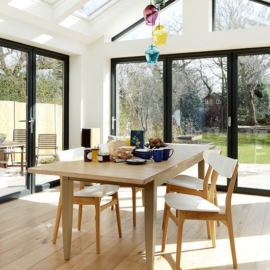 White And Oak Kitchen Diner: Conservatory Dining Area With Oak Flooring