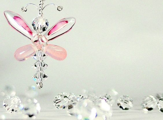 These dainty pink butterfly / fairy earrings are hand crafted from Swarovski…