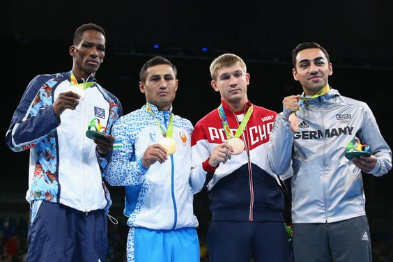 L-R) Silver medalist Lorenzo Sotomayor Collazo of Azerbaijan, gold medalist Fazliddin Gaibnazarov of Uzbekistan and bronze medalists Vitaly Dunaytsev of Russia and Artem Harutyunyan of Germany pose on the podium during the medal ceremony for the Men's Boxing Light Welter (64kg) on Day 16 of the Rio 2016 Olympic Games at Riocentro - Pavilion 6 on August 21, 2016 in Rio de Janeiro, Brazil.
