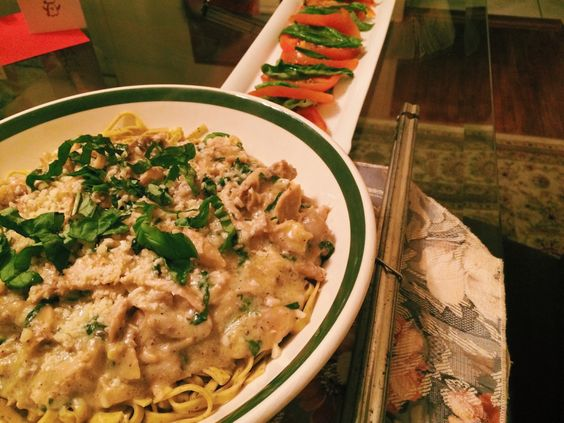 """Skinny"" chicken Alfredo with garlic and basil noodles and a tomato & basil salad."