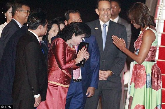Politeness incarnate: The first lady has since scrubbed up on her manners significantly. She is pictured above greeting Bun Rany, the wife of Cambodian Prime Minister Hun Sen