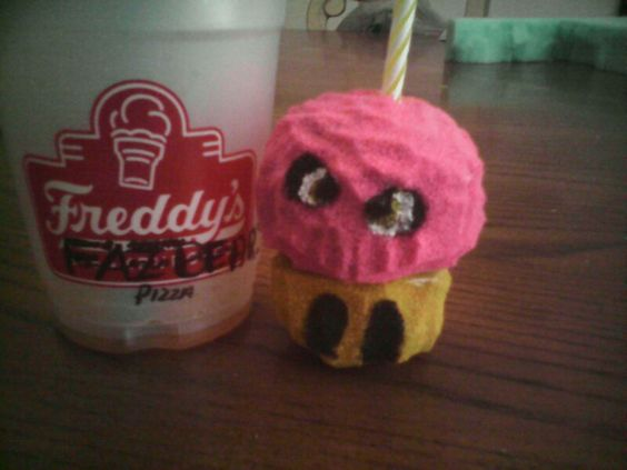 Mr. Carl cupcake! So cute! So...squishy. Hes my first successfully squishy outta foam\sponge. He's also gotta cute little candle....hes kinda kawaii..suggest other characters!