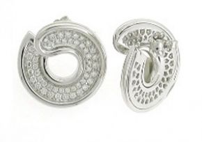 First Circle Diamond Earrings  A pair of diamond set circular stud earrings by Enrico Capra in 18ct white gold. These earrings are set with round brilliant cut diamonds totalling 0.31ct. The weight for the pair of earrings is 5.7gms. Matching pendant and ring available.